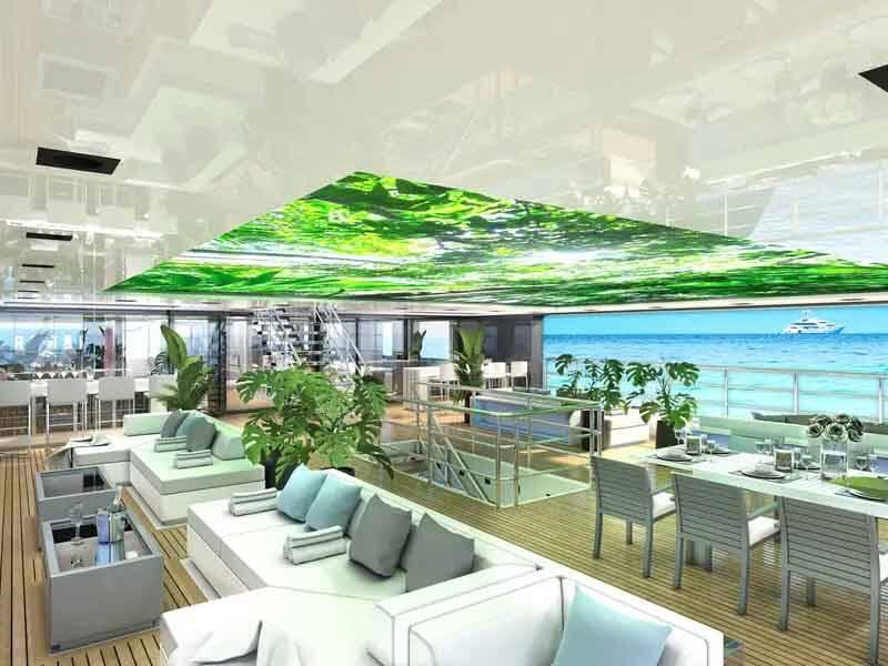 """Para viagens a locais com clima mais frio, existem espaços protegidos com painéis de LED no teto, permitindo uma """"paisagem de teto simulada e experiências imersivas virtuais""""."""